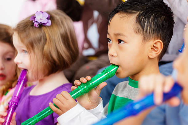 preschool children in a music class - recorder stock photos and pictures