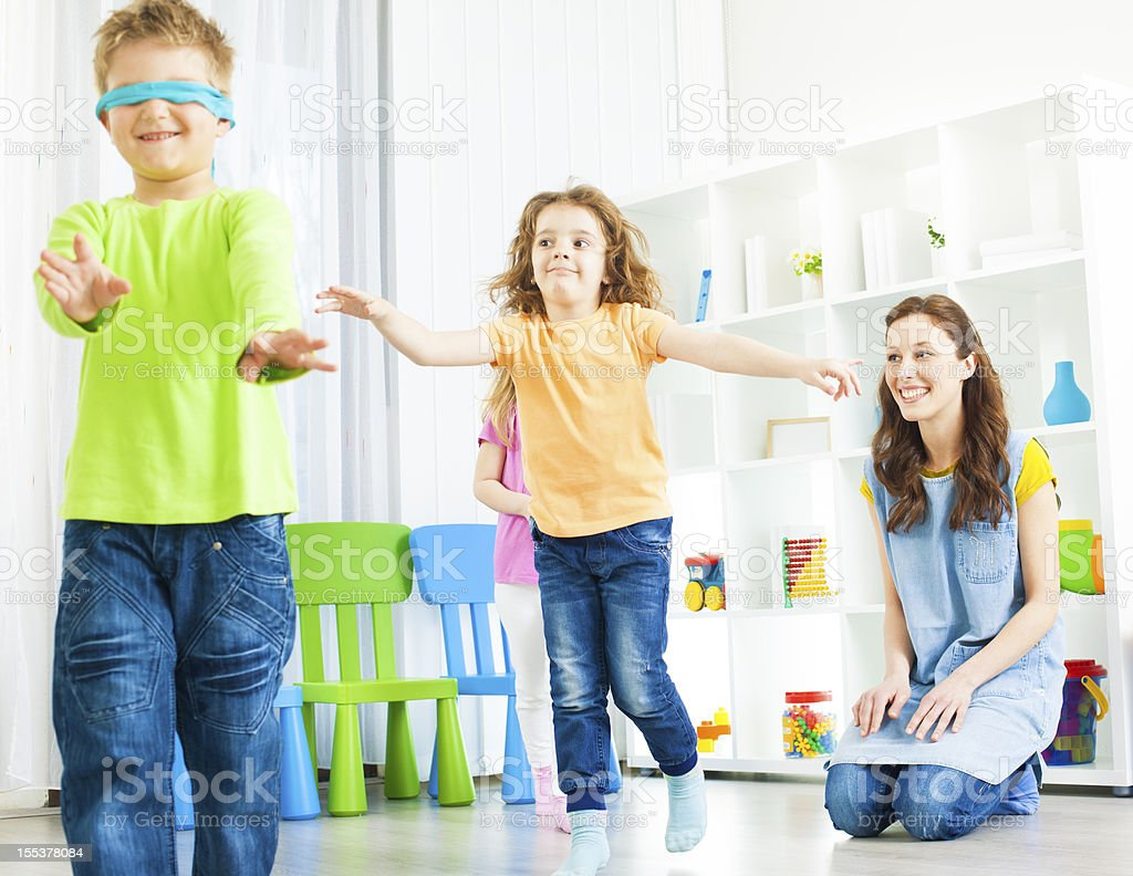 Preschool: Children Playing Hide and Seek. royalty-free stock photo
