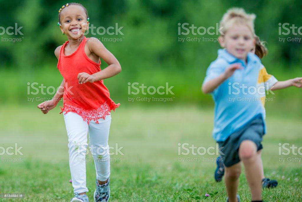 Preschool Children Running Together
