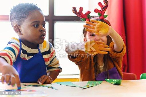 Preschool kids doing homemade decorations for Christmas, Quebec, Canada