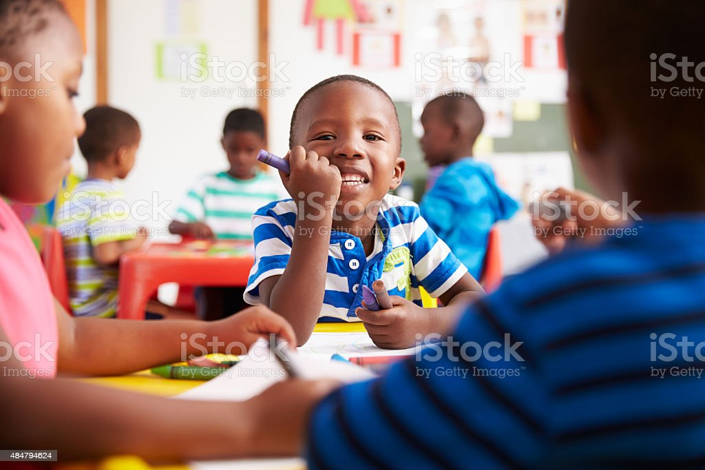 Preschool class in South Africa, boy looking to camera stock photo