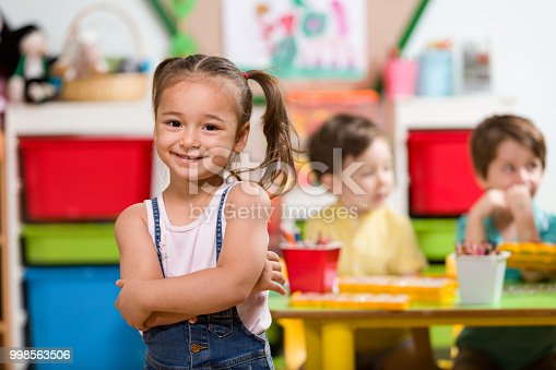 Little girl posing in classroom.