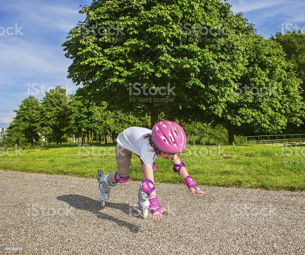 Preschool girl  falling down stock photo