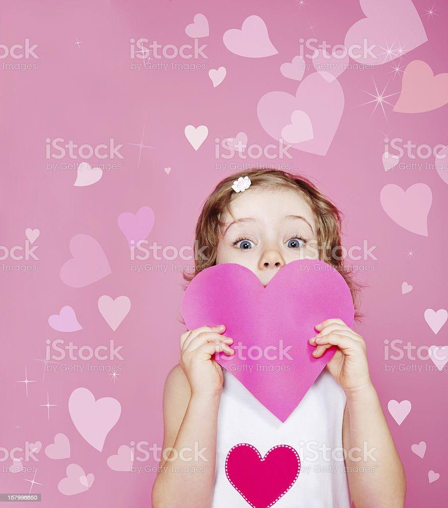 Preschool girl holding paper heart stock photo