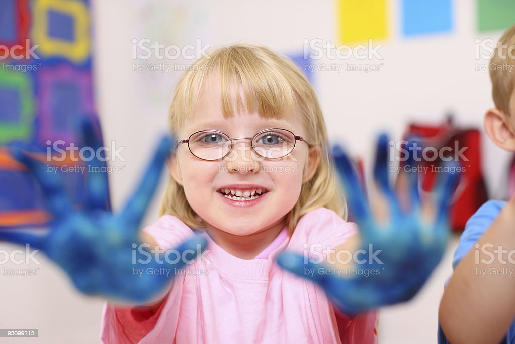 Preschool girl with hands covered in paint royalty-free stock photo
