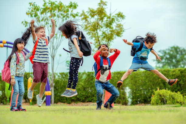 preschool in class kids preschool kindergarten enjoy and happy jumping on the field of playground after school class is over to retuning home schoolboy stock pictures, royalty-free photos & images