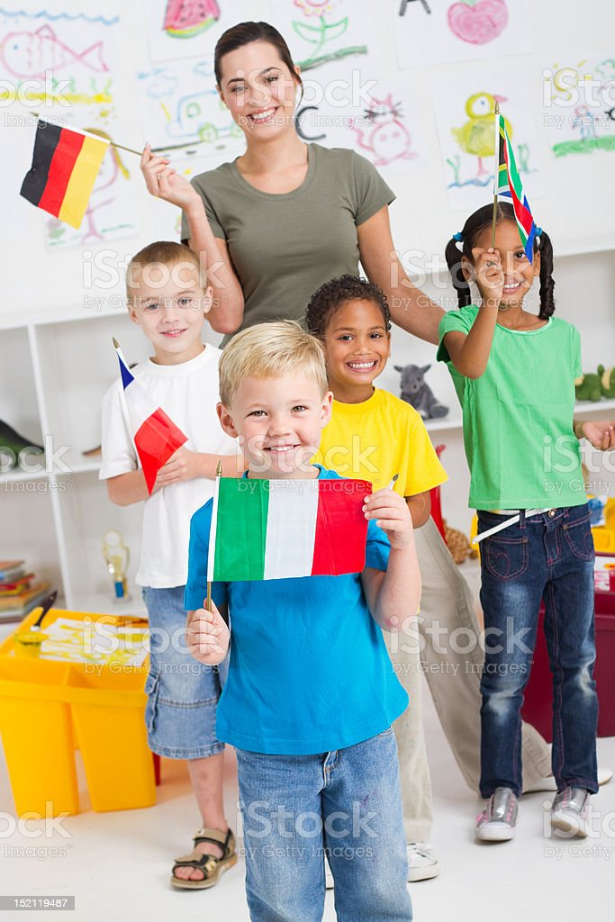 preschool kids and teacher with flags royalty-free stock photo