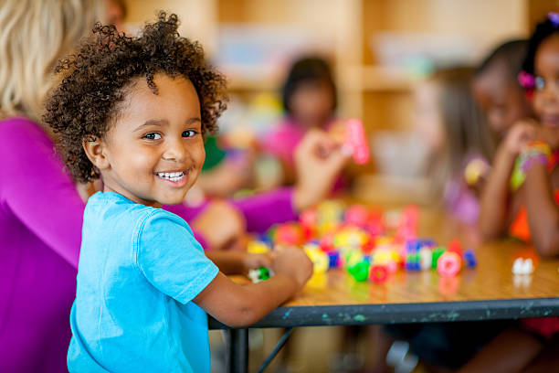 preschool kids Group of kids playing with toy bricks 2 3 years stock pictures, royalty-free photos & images