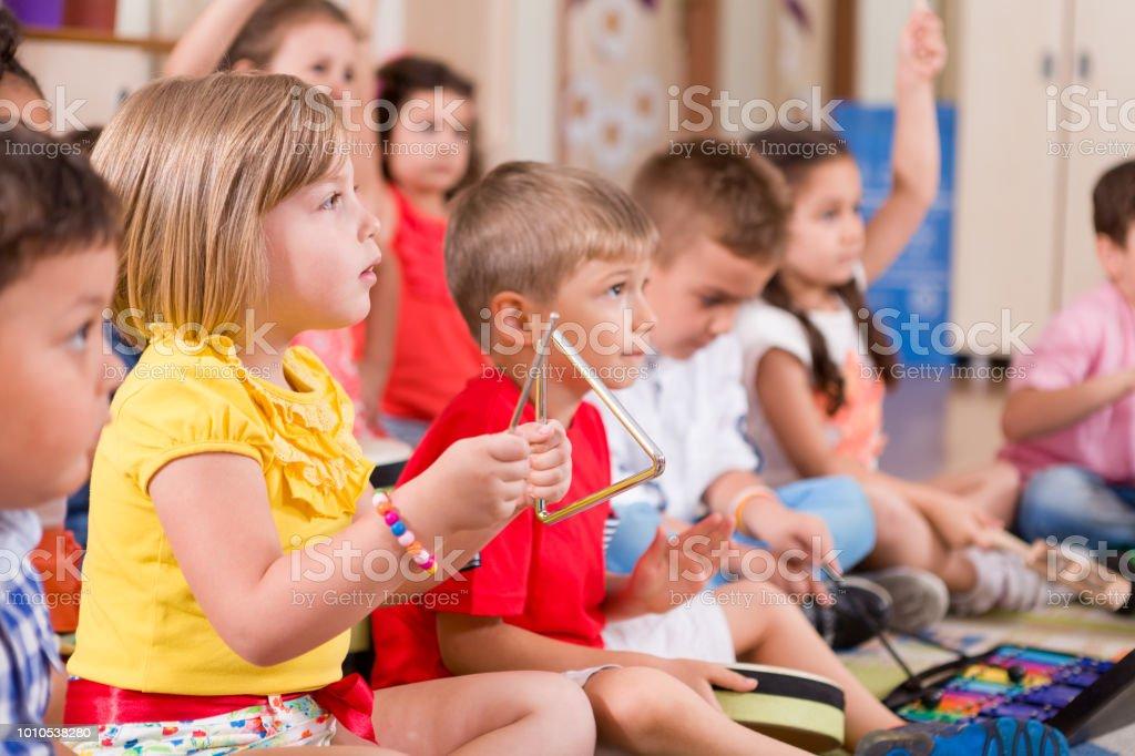 Preschool child in music classroom.