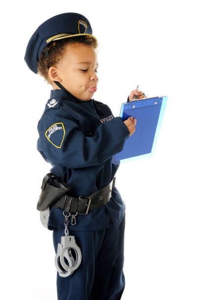preschool police writing a ticket - boy handcuffs stock pictures, royalty-free photos & images