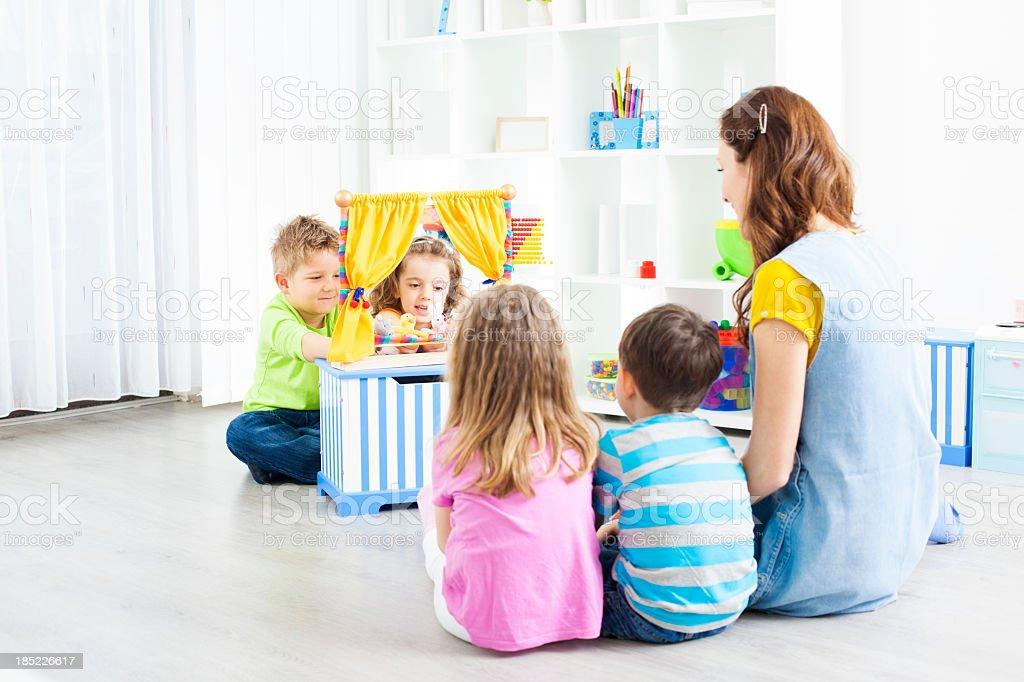 Preschool: Preschoolers Craft Activities Puppet Show. royalty-free stock photo