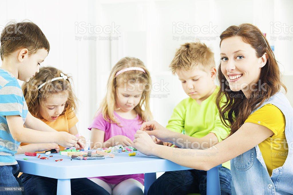 Preschool: Preschoolers Craft Activities with playdo. royalty-free stock photo