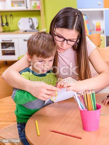 639271192istockphoto Preschool Taecher Gives Help To a Cute Boy 509170348