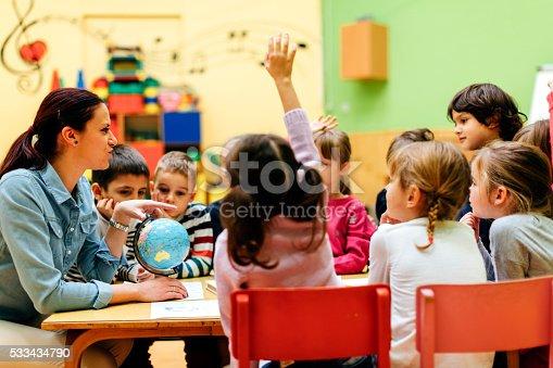 istock Preschool teacher and children in classroom 533434790