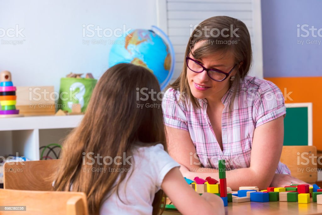 Mother with creative kid having fun time together. Teacher and child...
