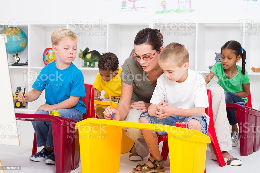 preschool teacher and students royalty-free stock photo
