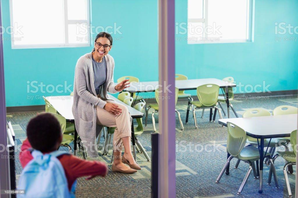 Preschool teacher in classroom greeting student stock photo more preschool teacher in classroom greeting student royalty free stock photo m4hsunfo