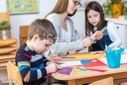 639271192istockphoto Preschool teacher with kids having creative activities 639858258