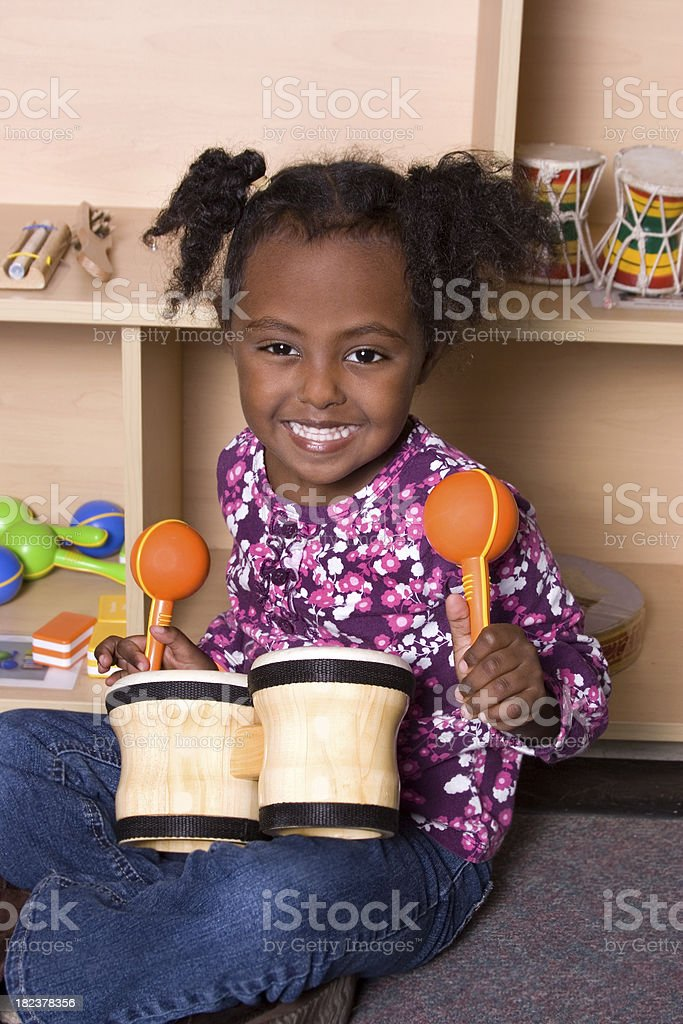 Preschooler at music station in school stock photo