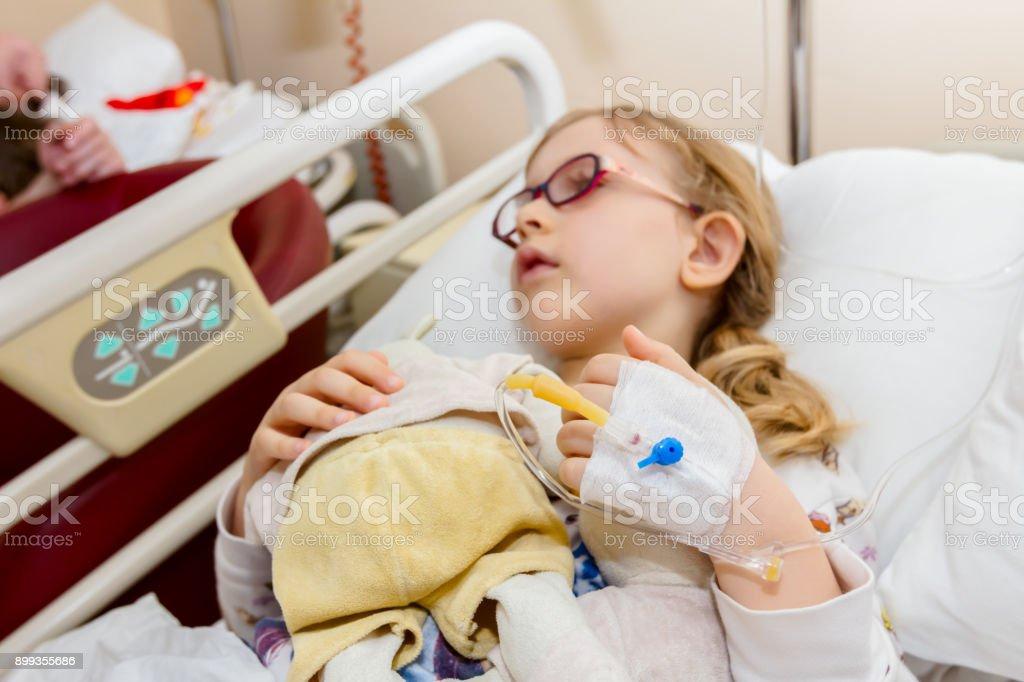 Preschooler child, patient is receiving on drip a saline stock photo