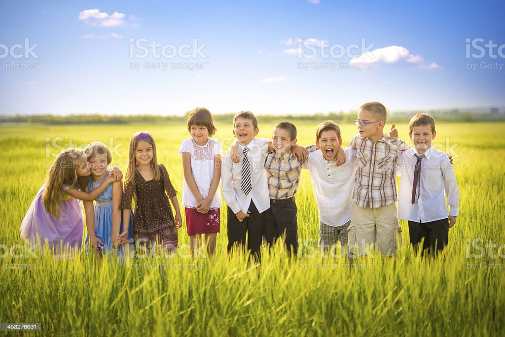 Preschooler fellows hanging out in nature stock photo