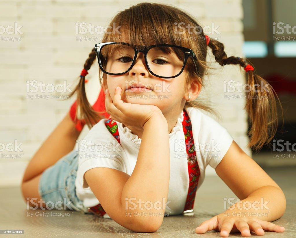 Preschooler girl on the floor stock photo