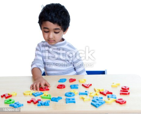 istock Preschooler Identifying Alphabets and Numbers, Isolated, White 152954157