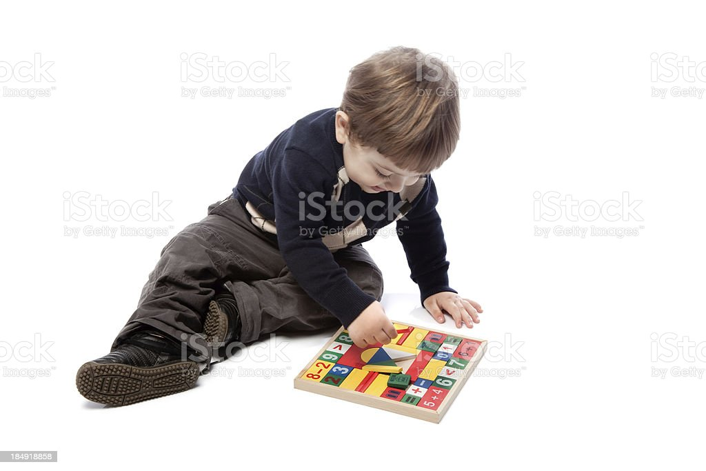 Preschooler little boy learning while playing stock photo