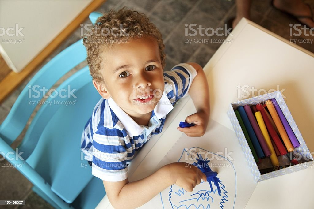 Preschooler Playing with a Box of Crayons stock photo
