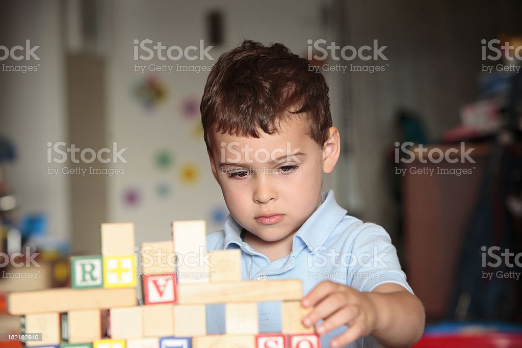 Preschooler playing with wooden toy blocks royalty-free stock photo