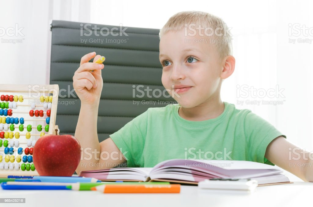 Preschooler, student doing homework at the desk royalty-free stock photo