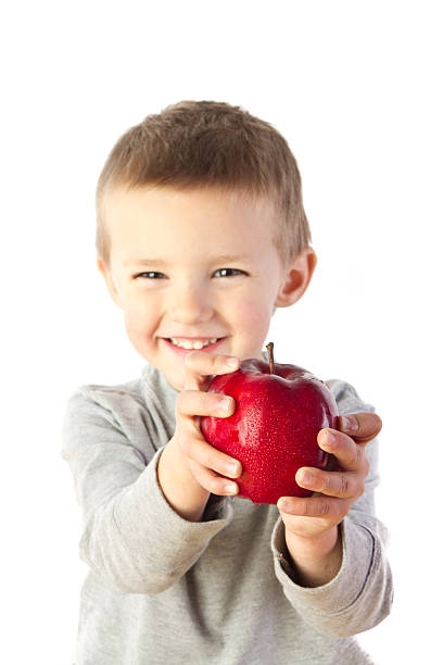 Preschooler with Apple stock photo