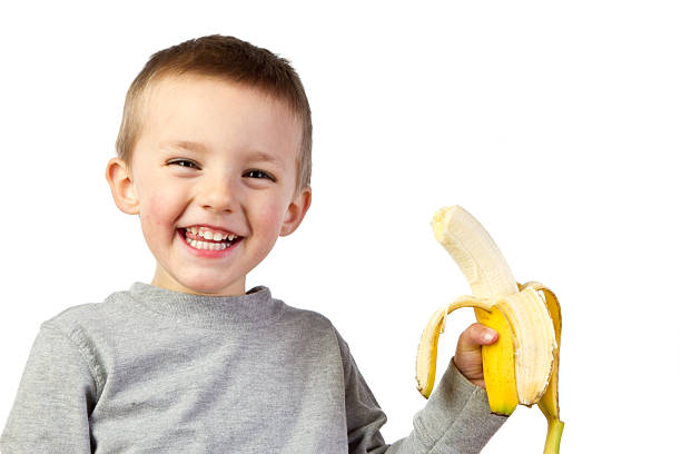 Preschooler with Banana stock photo