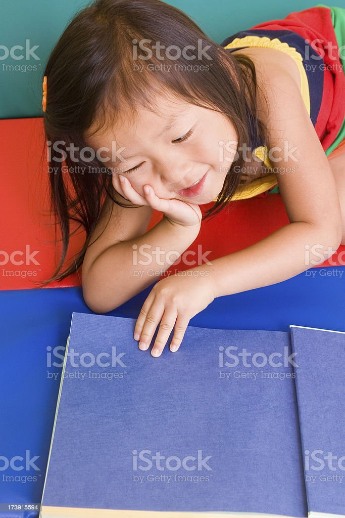 Preschooler with book series royalty-free stock photo