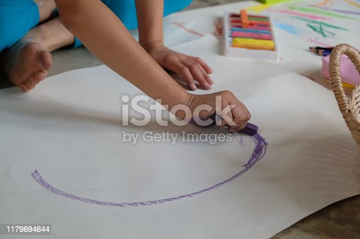 623300522 istock photo Preschoolers are practicing coloring on white paper. 1179694644