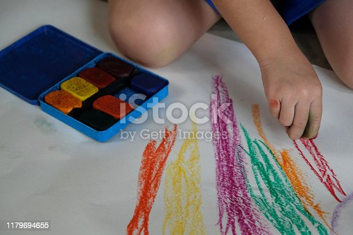623300522 istock photo Preschoolers are practicing coloring on white paper. 1179694655