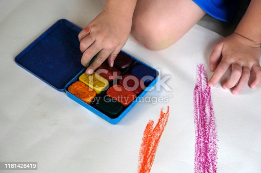 623300522 istock photo Preschoolers are practicing coloring on white paper. 1181426419