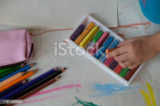623300522 istock photo Preschoolers are practicing coloring on white paper. 1181433002