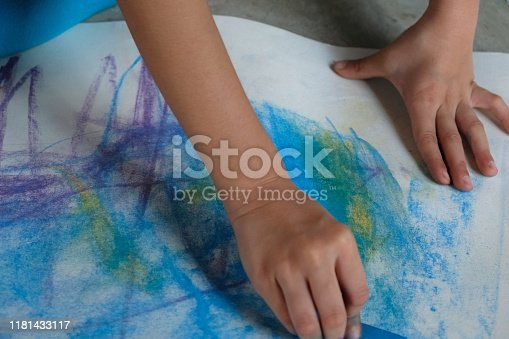 623300522 istock photo Preschoolers are practicing coloring on white paper. 1181433117