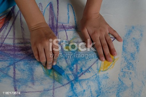 623300522 istock photo Preschoolers are practicing coloring on white paper. 1182173574