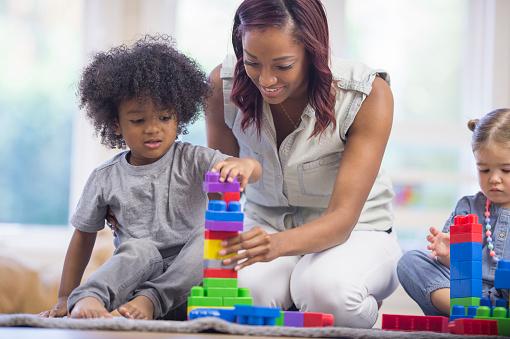 639403466 istock photo Preschoolers Building Block Towers 514561196