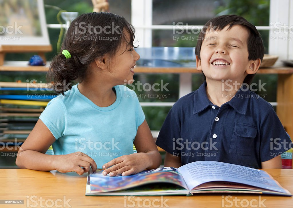 Preschoolers enjoying a book stock photo