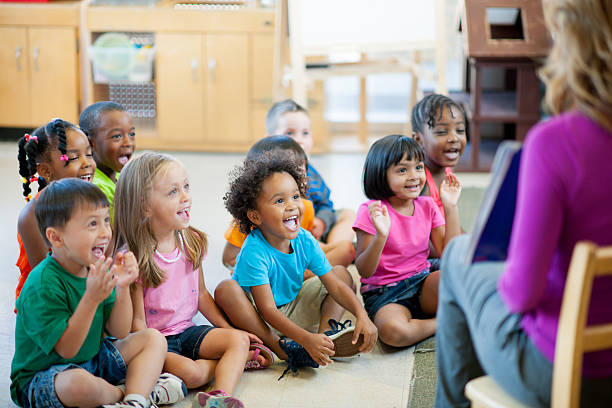 Pre-schoolers in classroom Multi ethnic group of pre-school children in a classroom. preschool age stock pictures, royalty-free photos & images