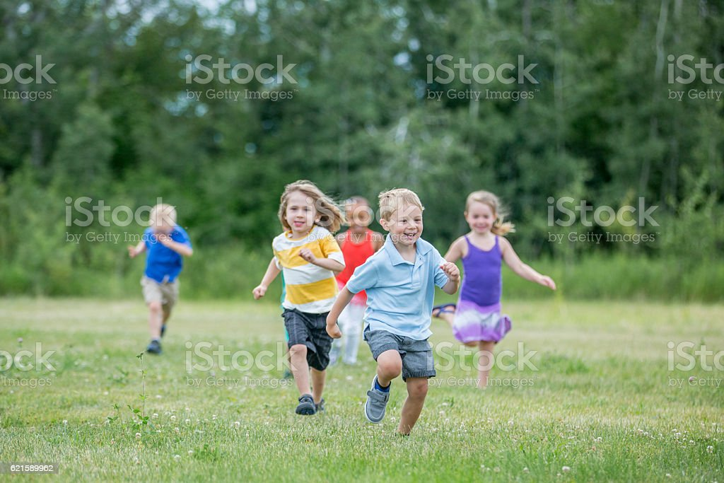Preschoolers Playing Outside stock photo