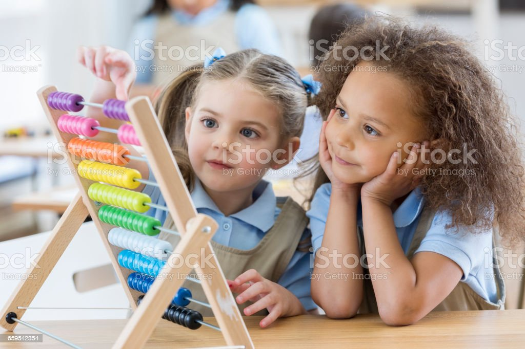 Preschoolers use abacus during class stock photo