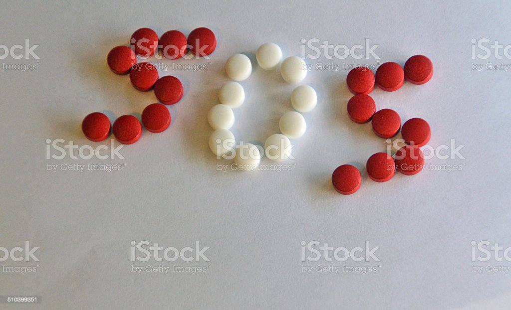 Presciption pills in S.O.S. shape stock photo
