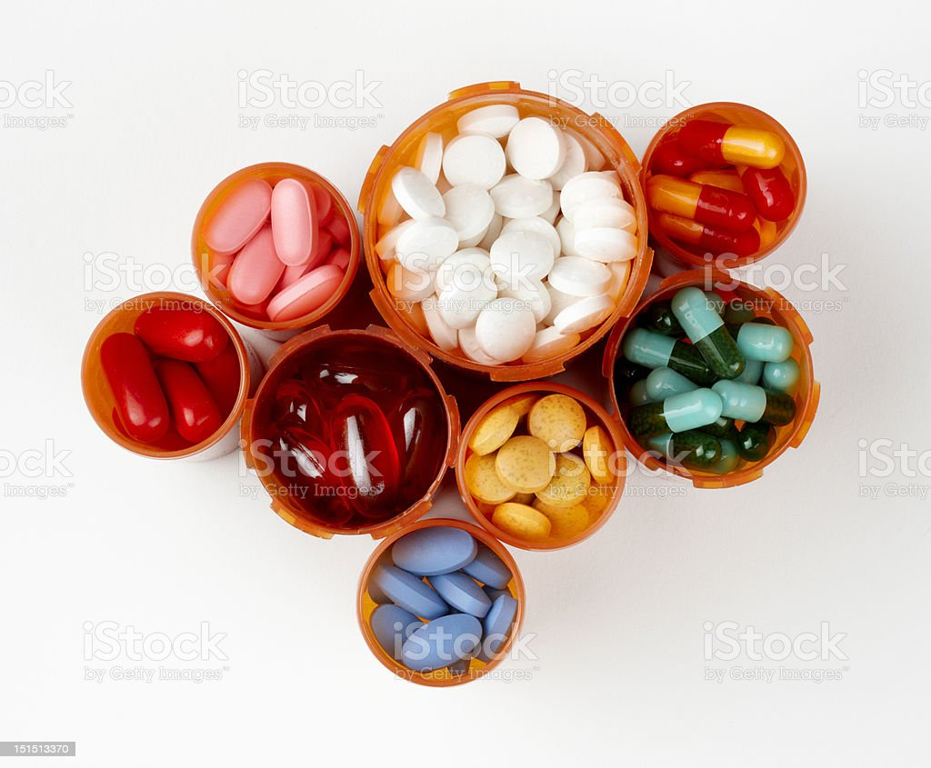 Prescription bottles filled with colorful medications stock photo