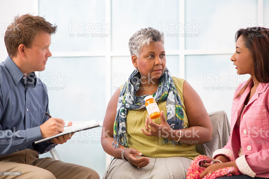 Prescription drug abuse. Counseling session. Mother, daughter. stock photo