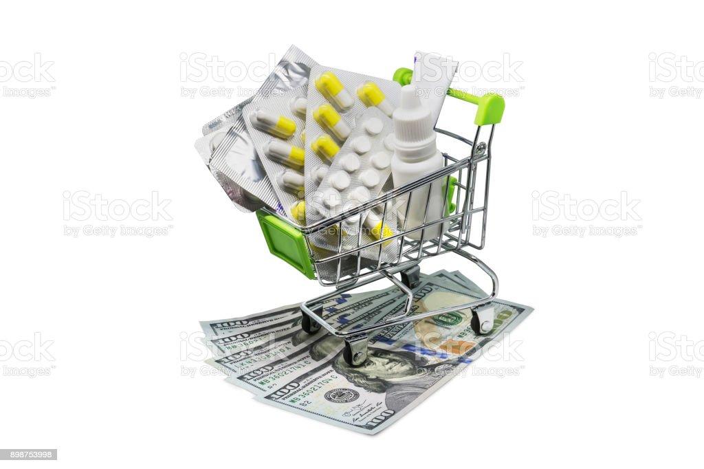 Prescription drugs on money representing rising health care costs. stock photo