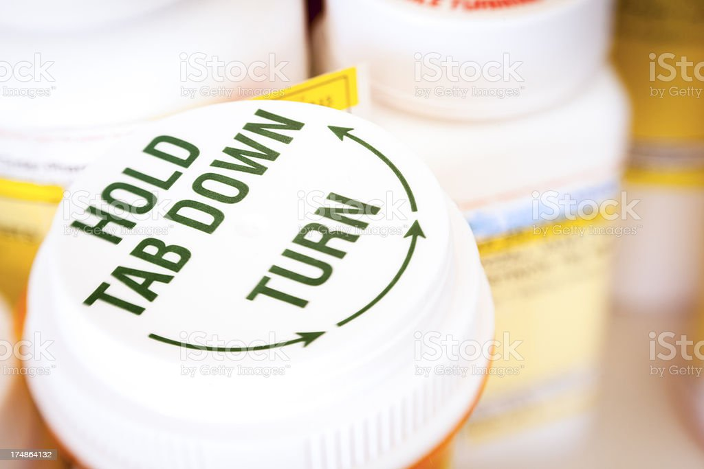 Prescription Drugs Macro of plastic medicine bottles and lids. Bottle Stock Photo